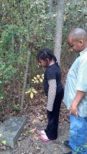 Photo: Kaleya & Q looking at Champ McClellan's headstone