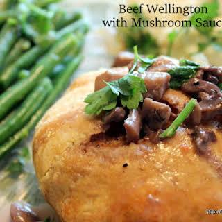 Delicious Beef Wellington with Mushroom Sauce.