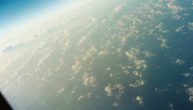 Photo: Pacific cloudscape, SF->Hnl. 2005.  Can you see the curvature of the Earth?  I almost thought I could.