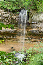 Photo: Why So Many Waterfalls?  Most of the waterfalls in this area are the result of water running over a shelf or cliffs of hard limey sandstone called the Munising Formation.