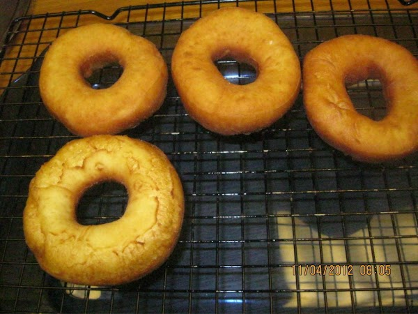 Place your donuts on a cooling rack over a pan.