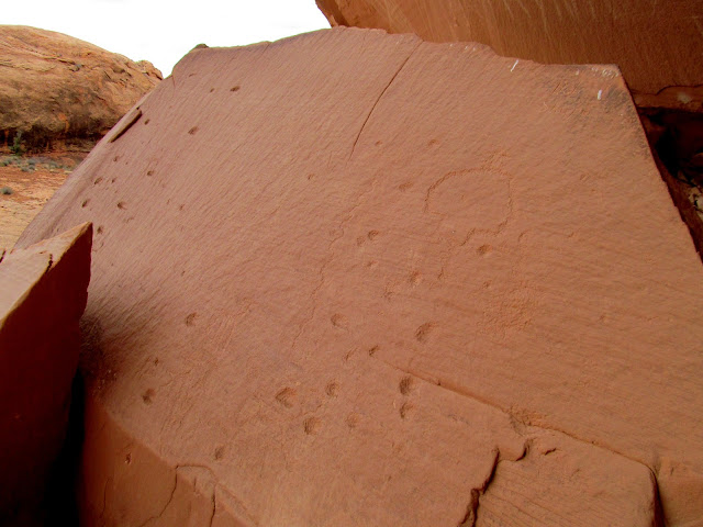 Carved dots and petroglyphs