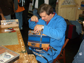 Photo: Mr. Arno Sussitz Demonstrating repair jobs on the mechanical bass section at the public Exhibition in Ried on 5.10.2008