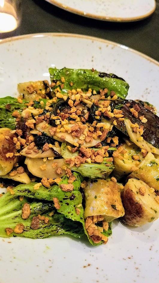Quaintrelle, Pacific Northwest cuisine focused Portland restaurant that emphasizes 80-85% local ingredients. Vegetables dish of sheep cheese dumplings, trumpet mushrooms, and radicchio