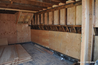 Photo: There are A35s on the shear wall joist blocks, but there's no uplift connection to the second floor shearwall.
