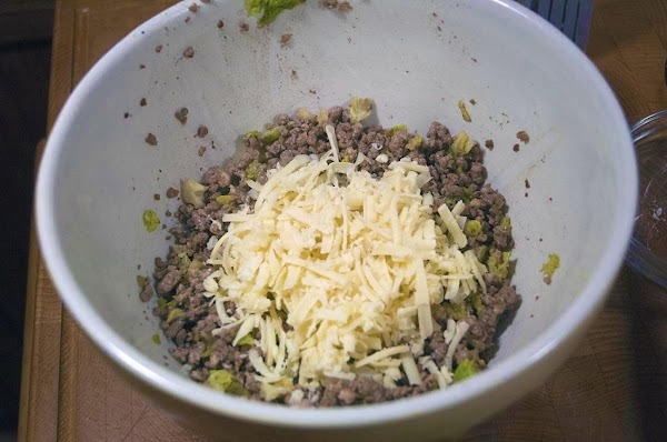 Add the cooled mixture to a bowl, and then add the cheese.