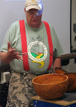 Photo: Bob Grudberg lights up as he describes his large cherry bowl.