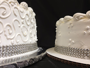 Photo: Up close view: individual wedding cakes. 3-dot cluster  and Town&Country border on middle cake. Each wrapped in silver diamond wrap & topped in traditional borders.