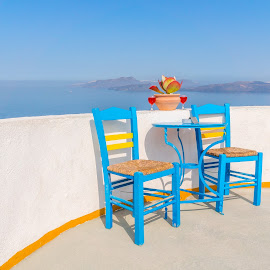 clean view by Nikos Diavatis - City,  Street & Park  Skylines ( wine, chairs, wine glass, greece, santorini )