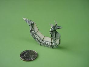 Photo: Model: Asian Dragon;  Creator: Gay Merrill Gross;  Folder: William Sattler;  1 dollar;  Publication: Dollar Bill Origami (John Montroll) ISBN 0-486-42982-2