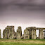 Stonehenge by Mike Woodford - Travel Locations Landmarks ( stonehenge, green, moss, solstice, stone, rock, circle, storm, permanence, worship, everlasting, lichen, ancient, permanent, historical )