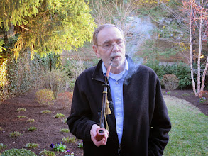 Photo: Smoking my great grandfather's lap pipe out in my yard on a special occasion. Smoking is not permitted inside.