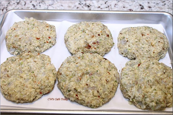 Form shrimp burgers - with a large ice cream scoop or large spoon, place...