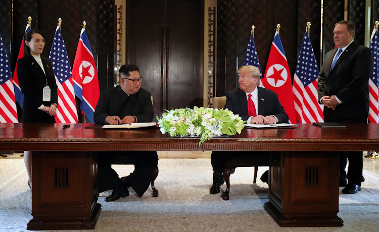 US President Donald Trump and North Korea's leader Kim Jong-un before signing documents that acknowledge the progress of the talks and pledge to keep momentum going, in Singapore.
