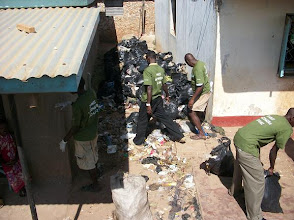 Photo: Sept - 17th - Community Trash Removal Our t-shirts for the youth said Jamii, Mazingira and Uchumi (Community, Environment and Economy)