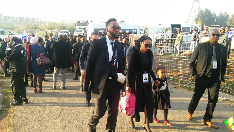 Family members arriving at Mama Winnie's home.