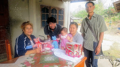 Photo: Chai Prakan: baby girl, Siripn, (4 months) with mum and Aoy and Yong Yut (Chai Prakan volunteer healthcare workers.