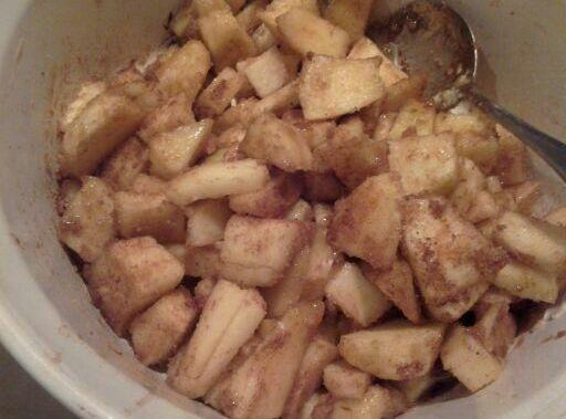 Chop core and place the apples in a bowl with melted butter and the...
