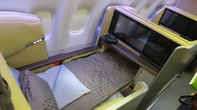 Photo: First class seat tricked out in bed mode Singapore Air's new B777-300ER
