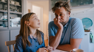 man and young girl talking