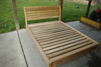 """Photo: Cherry platform bed (Queen size), under construction.  Photo taken during """"dry"""" assembly trial (i.e., no glue). (Please ignore tractor!)"""