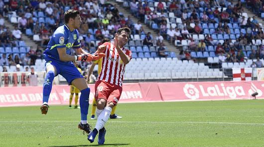 Álvaro Giménez en una acción con Raúl Lizoain.