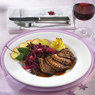 Roast Goose Breast with Duchess Potatoes and Red Cabbage.