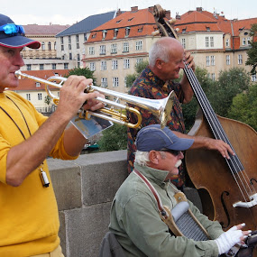 Trumpeter at the Charles Bridge by Luboš Zámiš - People Musicians & Entertainers