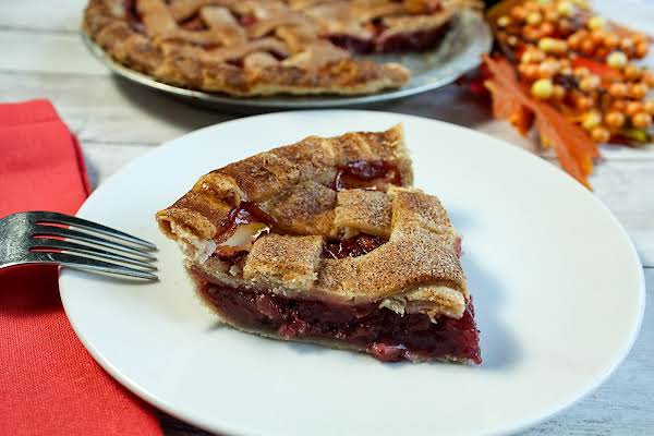 A Slice Of Apple Cranberry Pie On A Plate.