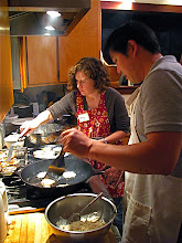 Photo: Amy and Derek frying daikon cakes 1