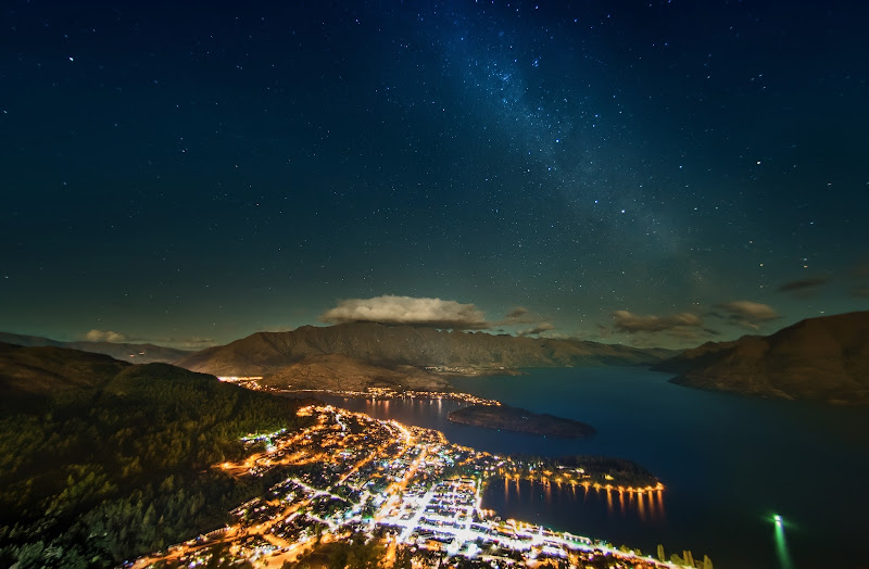 Photo: The Glittering Stars over Queenstown, New Zealand  We took this one about midnight last night because the sun was setting all the way around 10 PM! And it sets so slowly here around 45 degrees south that the sky stays light up until about midnight...  Took this last night from above Queenstown - EXIF info for you photo geeks like me :)  Geeky Shot Info: 20 seconds, f/2.8, -1EV, ISO 1250, Nikon D800, Nikon 16mm fisheye (corrected in PS with Lens Correction)