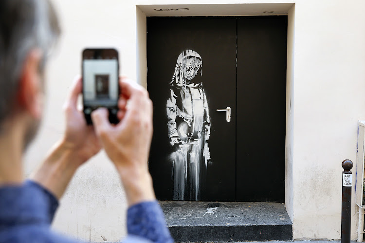 Banksy's stolen painting at the Bataclan theatre in Paris.