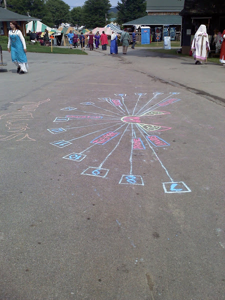 Photo: Sundial Completed WHILE it Rained, making the chalk flow like paint. Notice the Liturgical hours.