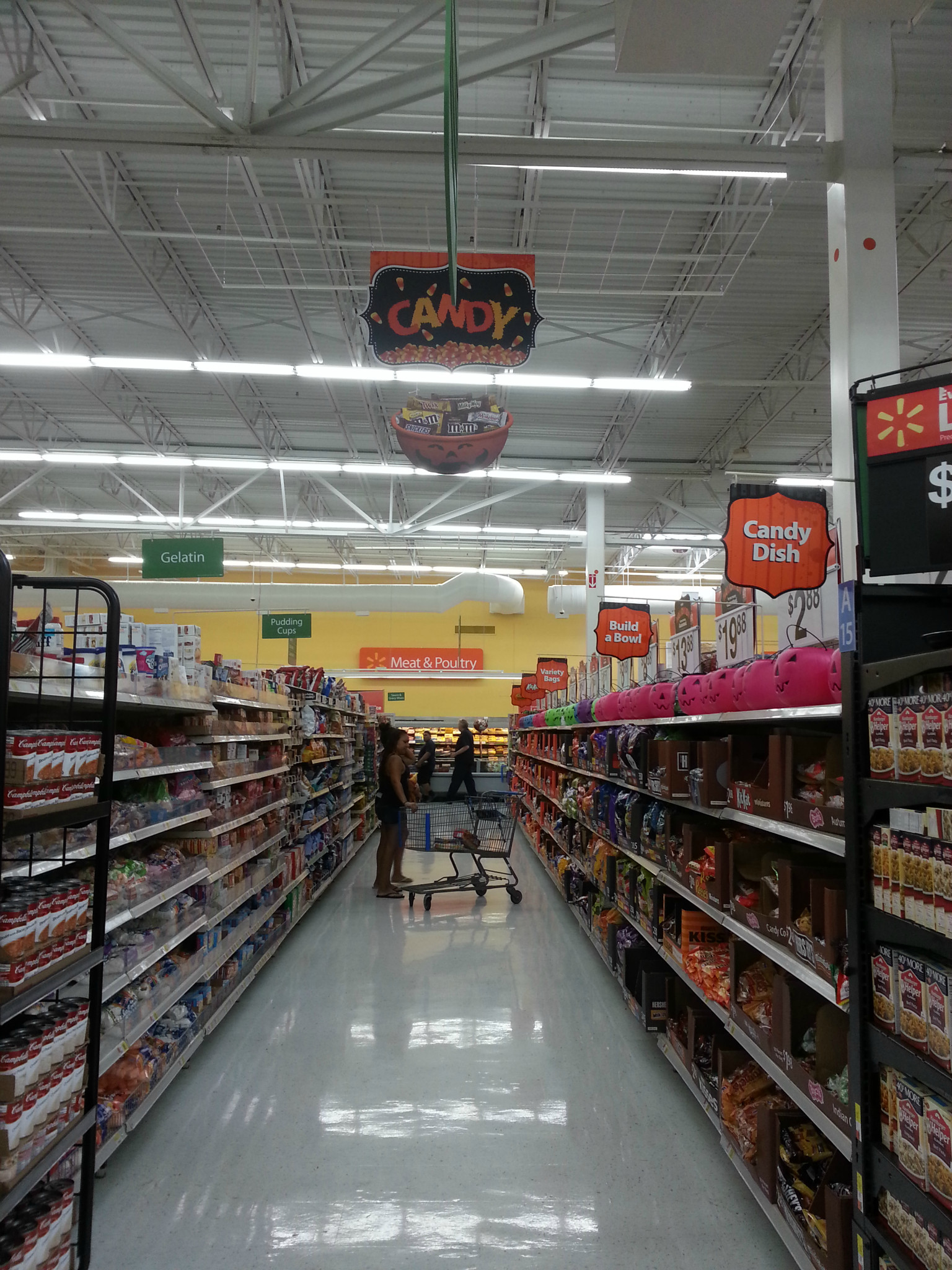 Photo: While browsing the candy isle I ran into a couple who started asking me if I was having a girl by the way I was carrying.