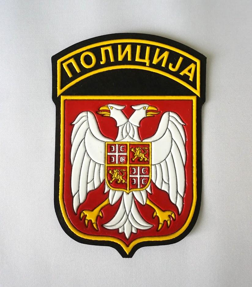 Gumirani amblem policije Srbije.