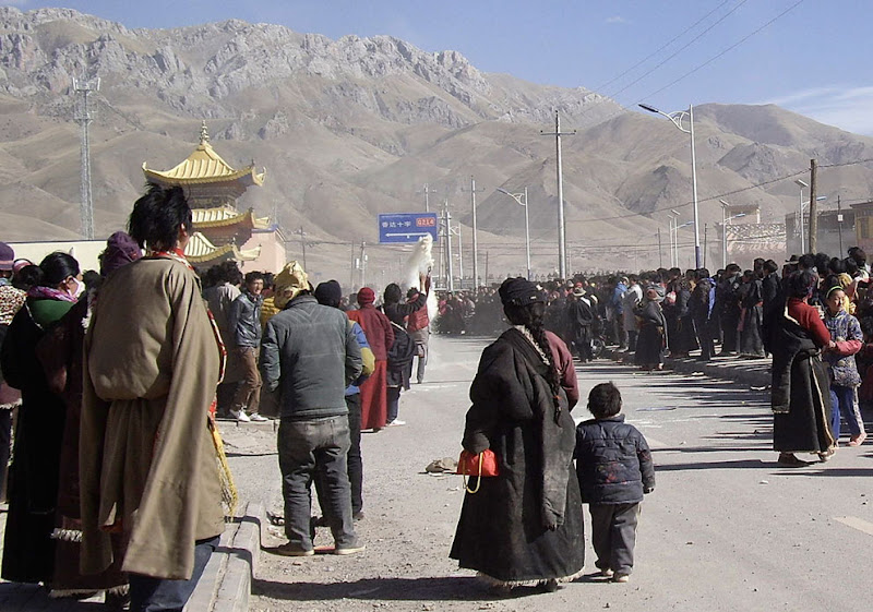 Photo: In this photo taken on Wednesday, February 8, 2012 and released by a person with contacts in China's Tibetan community, Tibetans throw what appeared to be dry tsampa, a popular Tibetan foodstuff, into the air as they gather on the side of a main street in Nangqian county, China's Qinghai province, to protest Chinese rule and to call for independence for Tibet and the return of the Dalai Lama from exile. (AP Photo) #   In this photo taken on Wednesday, February 8, 2012 and released by a person with contacts