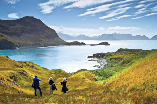 Guests from a Lindblad Expedition ship hike step into a landscape painting in South Georgia.