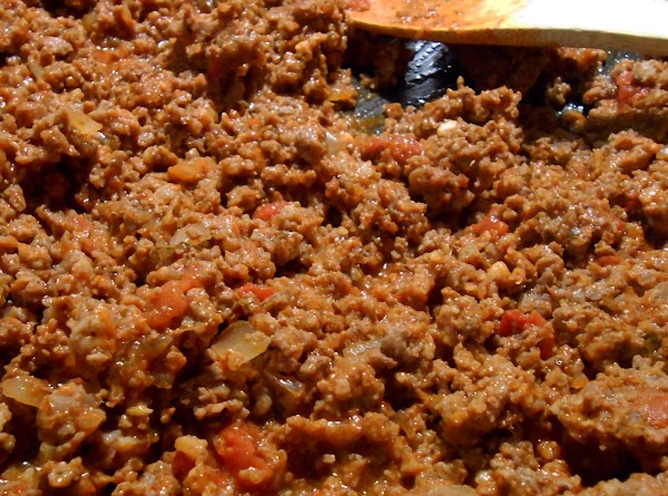 Brown ground beef, Italian sausage, onion and garlic.  Drain any excess fat. ...