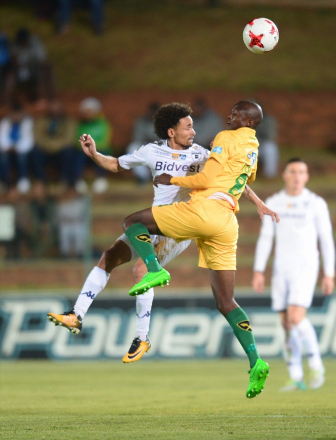Daylon Claasen of Wits and Nkanyiso Cele of Golden Arrows during the MTN 8 quarter final match between Bidvest Wits and Golden Arrows at Bidvest Stadium on August 11, 2017 in Johannesburg, South Africa.
