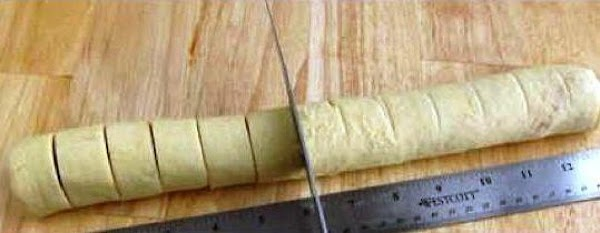 Roll tightly lengthwise and slice each into 4 or 5 pieces.