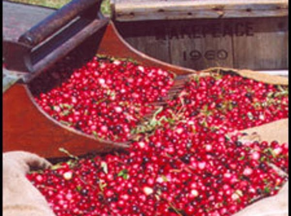 Wash and dry berries and prick each with a needle. Boil sugar and water...
