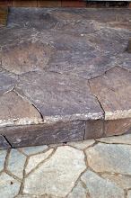Photo: Consider facing over concrete with natural or synthetic stone.