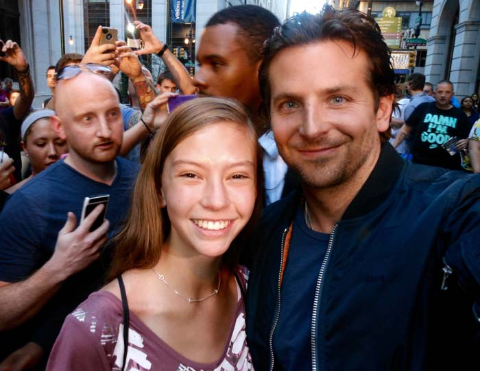 Bradley Cooper poses with a young fan in 2012.