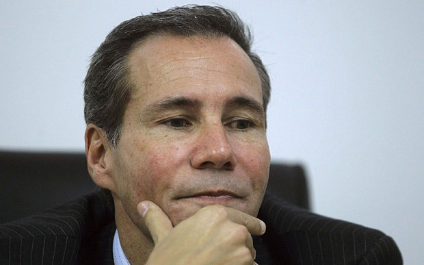 Late Argentine prosecutor Alberto Nisman pauses during a meeting with journalists