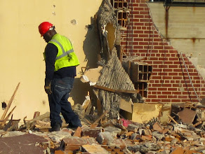 Photo: This poor guy is hand-picking metal out of the debris.
