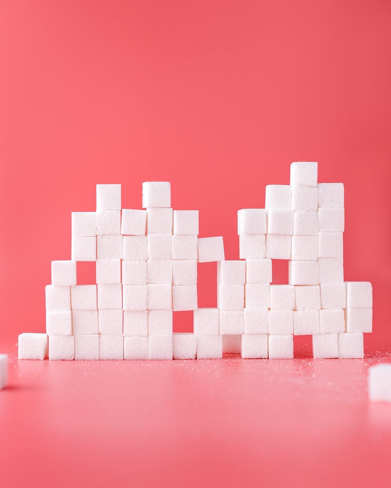 A stack of sugar cubes. Sugar is a hidden ingredient in many everyday processed foods.