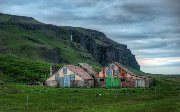 Photo: Remote Farmhouse with Waterfall Southern Iceland  On one of my first nights in Iceland, I was driving along the southern coast. Pristine farms are plopped along the side of the road every few miles. As I began to approach one of the volcanic areas, the terrain changed enough so there were huge waterfalls in many of the vistas. This one was nestled deep behind the farmhouse, and it seemed like a nice little spot for a photo.  from Trey Ratcliff at www.stuckincustoms.com