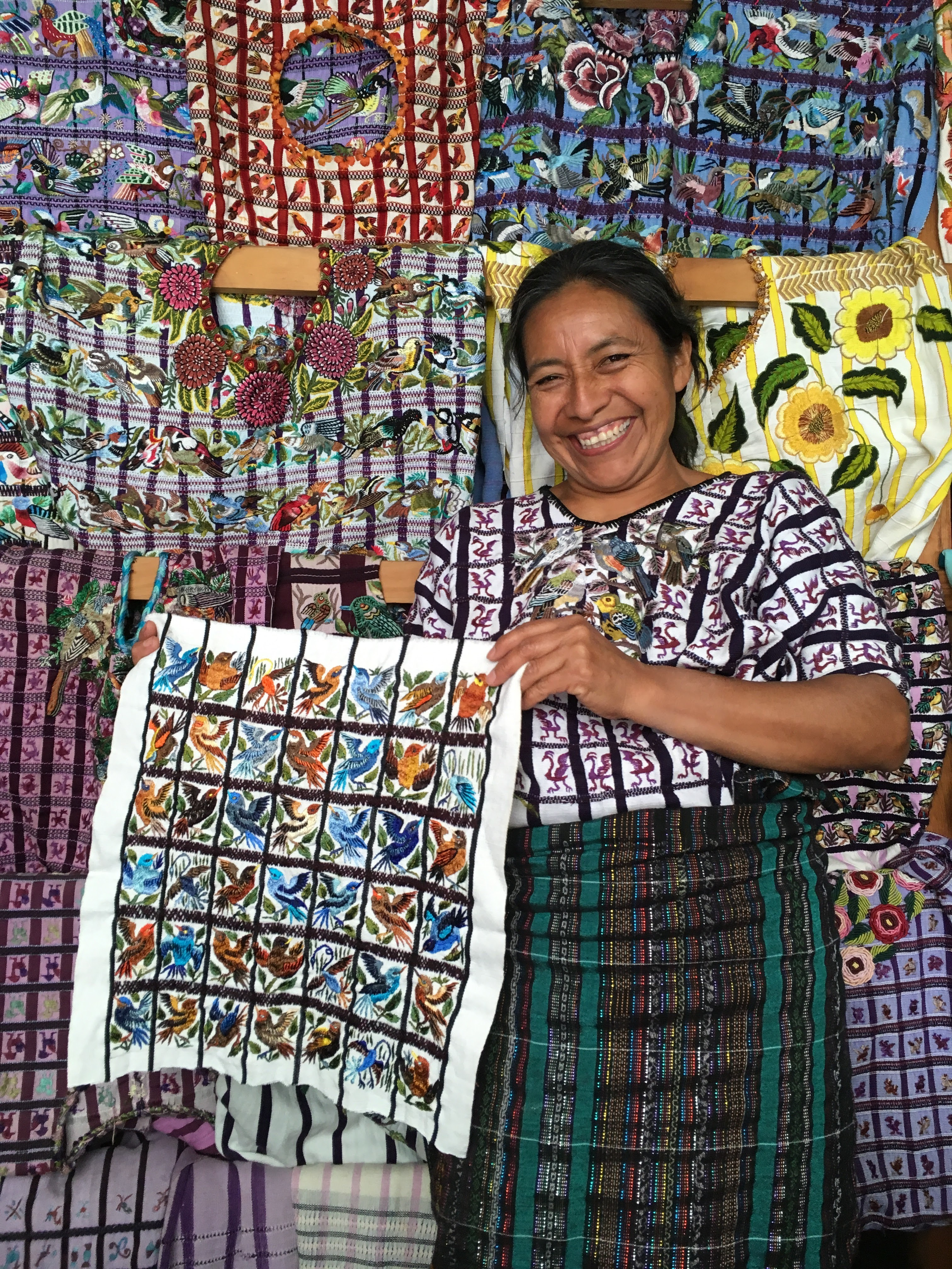 Senora Consuela and her embroidery works in Santiago.