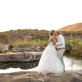African Sunset by Giselle Hammond - Wedding Bride & Groom ( bride, groom, africa, nature, south africa, dam, bride and groom, golden hour, kissing, sunset, wedding, photoshoot, posing )
