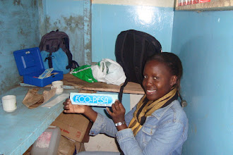 Photo: Debora Odungo in our small community office. Where we give out information, register businesses and buy and sell Eco-Pesa for shillings.